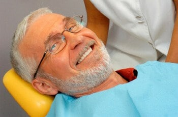 an old man smiling
