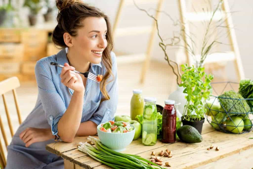 Lady eating plant based foods for better hydration