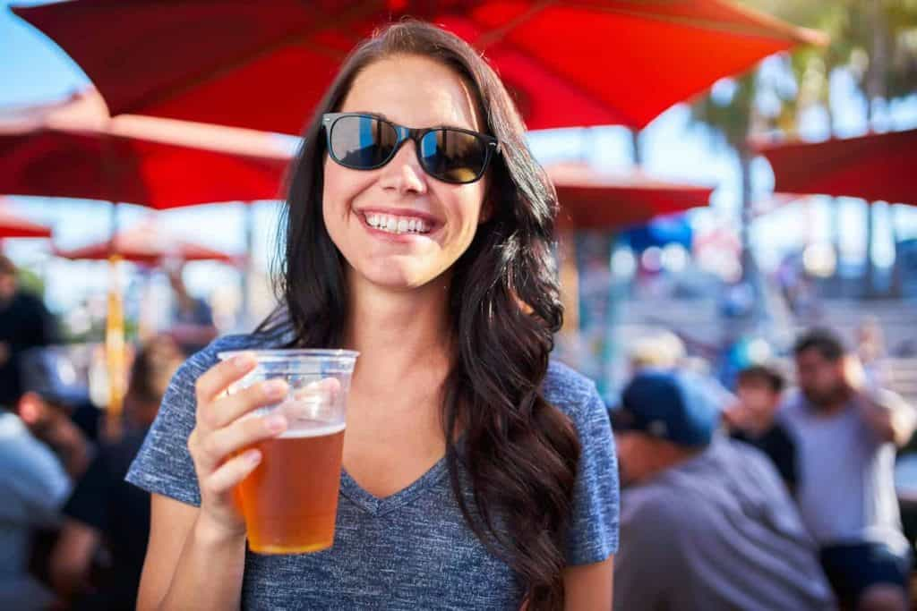 lady holding and drinking beer